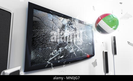 Soccer ball with the flag of United Arab Emirates flying through a shattering tv screen.(3D rendering series) - Stock Photo