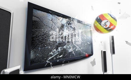 Soccer ball with the flag of Uganda flying through a shattering tv screen.(3D rendering series) - Stock Photo