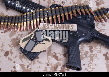US Marines concept with firearms, boots and camouflaged uniform