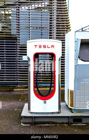 Supercharger - the Tesla car charging station, London, UK - Stock Photo