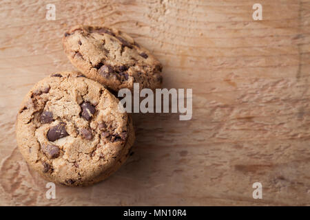 Cookies with chocolate chips on a wooden table. Top view with copy space - Stock Photo