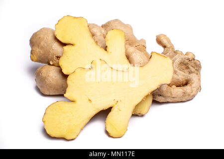 Fresh big ginger root close up copy space isolated on white background - Stock Photo