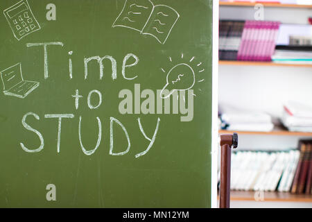 Inscription on the blackboard in the classroom - Time to study - Stock Photo