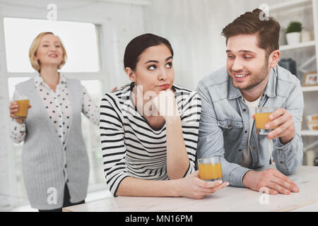 Nice young couple living together with the mother - Stock Photo