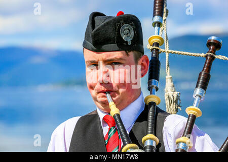 Gourock, UK. 13th May 2018. Gourock starts off the 'Games' season with hundreds of pipers, 'heavies' and dancers from across the country, all competing in traditional Scottish Highland Games that include pipe bands, individual piping, country dancing for all ages and all the traditional heavyweight competitions such as tossing the caber, throwing the hammer and lifting the Keppoch Stone.Thousands of spectators turned out on a fine sunny May Sunday to cheer on all the competitors. Credit: Findlay/Alamy Live News - Stock Photo