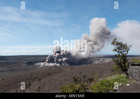 Hawaii, USA 12th May 2018. A grey ash plume rises from the Kilauea volcano May 11, 2018 in Hawaii. The recent eruption continues destroying homes, forcing evacuations and spewing lava and poison gas on the Big Island of Hawaii. Credit: Planetpix/Alamy Live News - Stock Photo
