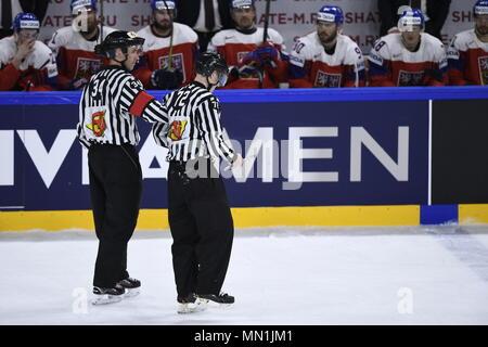 Kodan, Denmark. 13th May, 2018. Referees L-R LINUS OHLUND and JON KILIAN are seen during the Ice Hockey World Championships match France vs Czech Republic, in Copenhagen, Denmark, May 13, 2018. Credit: Ondrej Deml/CTK Photo/Alamy Live News - Stock Photo