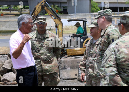 Honolulu, HI – Hawaii National Guard Brigade Engineer Battalion briefs Brig. Gen. Kenneth S. Hara and Maj. Gen. Arthur J. Logan recieve a briefing on the Kahauiki Village Homeless Relocation Project, Aug. 9, 2017 in Honolulu, Hawaii. Soldiers continued to prepare foundation slabs for future affordable housing for homeless families. (U.S. Army National Guard photo by Spc. Matthew A. Foster) - Stock Photo