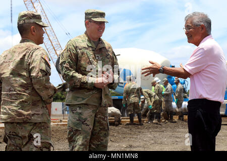 Honolulu, HI – Hawaii National Guard Brig. Gen. Kenneth S. Hara and Maj. Gen. Arthur J. Logan at the Kahauiki Village Homeless Relocation Project, Aug. 9, 2017 in Honolulu, Hawaii. Soldiers continued to prepare foundation slabs for future affordable housing for homeless families. (U.S. Army National Guard photo by Spc. Matthew A. Foster) - Stock Photo