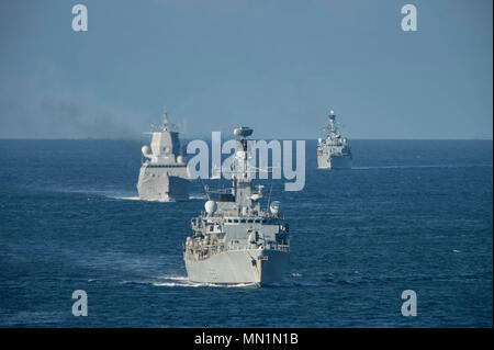 170807-N-AJ467-072 THE MINCH, Scotland (Aug. 7, 2017) Royal Navy Type 23 Duke-class frigates HMS Wesminster (F237), center, and HMS Iron Duke (F234), right, along with the Royal Norwegian Navy frigate Helge Ingstad (F313), transit The Minch, Scotland, during exercise Saxon Warrior 2017. The U.S. and United Kingdom co-hosted carrier strike group exercise demonstrates interoperability and capability to respond to crises and deter potential threats. (U.S. Navy photo by Mass Communication Specialist Seaman Darien Weigel/Released) - Stock Photo