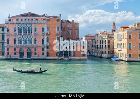 Palaces on Grand Canal with traditional Gondola. Venice, Italy - Stock Photo