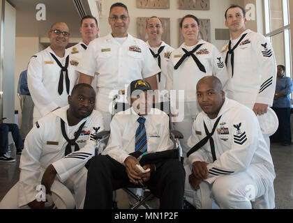 170810-XN169-182 SAN DIEGO (Aug. 10, 2017) Retired Chief Steward Andrew Mills, poses for a photo with Sailors selected for advancement to chief petty officer. Mills is a World War II veteran who served in the Navy as a steward on the USS Yorktown (CV-5). He is one of the last survivors of the Battle of Midway. (U.S. Navy photo by Mass Communication Specialist Seaman Apprentice Lasheba M. James/Released) - Stock Photo