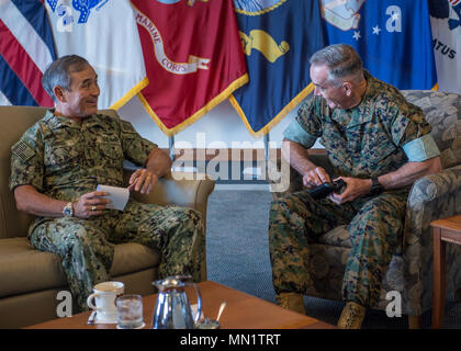 170811-N-ON707-009 CAMP H.M. SMITH, Hawaii (August 11, 2017)— Adm. Harry Harris, Commander of U.S. Pacific Command (PACOM), has a conversation with Marine Corps Gen. Joseph Dunford, Jr., Chairman of the Joint Chiefs of Staff, at PACOM Headquarters. Hawaii is the first stop in Dunford's travel of the PACOM area of responsibility. (U.S. Navy photo by Mass Communication 2nd Class James Mullen/Released) - Stock Photo