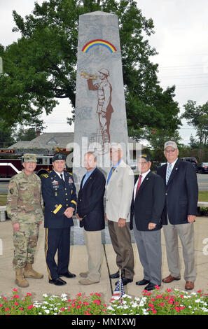 Present and past commanders of the 42nd Infantry Division pose for a photograph in front of the Rainbow Division monument in Garden City, N.Y on August 12, 2017 prior to a ceremony marking the 100th anniversary of the Rainbow Division. They are, from left, Major General Steven Ferrari, the current commander; Major General Harry Miller; Major General (retired) Steven Wickstrom; Brig. Gen. (retired) Paul Genereux; Major General (retired) Joseph Taluto, and Major General (retired) Thomas Kinley. New York State Division of Military and Naval Affairs photo by New York Guard Capt. Mark Getman. - Stock Photo