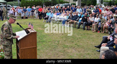 Major General Steven Ferrari, the commander of the 42nd Infantry Division, speaks during a ceremony marking the Rainbow Division's centennial on Saturday, August 12, 2017 at Garden City, N.Y. The ceremony marked the division's concentration at Camp Albert Mills here in August and September 1017. New York State Division of Military and Naval Affairs photo by New York Guard Capt. Mark Getman. - Stock Photo