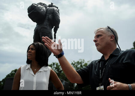 Steven Haggett, 24th Special Operations Wing chief of protocol, provides information about the Special Tactics Memorial to Tonya Wright, left, spouse of Chief Master Sgt. of the Air Force Kaleth O. Wright, at Hurlburt Field, Fla., Aug. 9, 2017. The memorial was unveiled Oct. 20, 2016, serving as a physical touchstone of the Special Tactics community's place in history.. (U.S. Air Force photo by Airman 1st Class Dennis Spain) - Stock Photo