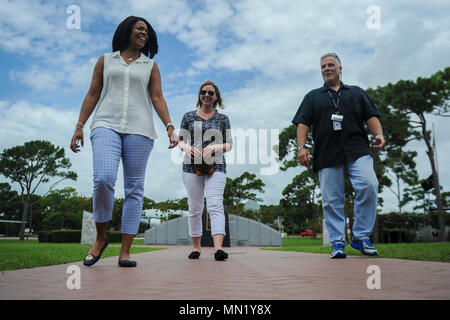 Tonya Wright, left, spouse of Chief Master Sgt. of the Air Force Kaleth O. Wright, leaves the special tactics memorial at Hurlburt Field, Fla., Aug. 9, 2017.  In the last 40 years, only ten Airmen have received the Air Force Cross, the service's highest medal it can bestow for valor in combat. Eight of those recipients were Special Tactics Airmen. Their names are etched into granite of the monument. (U.S. Air Force photo by Airman 1st Class Dennis Spain) - Stock Photo