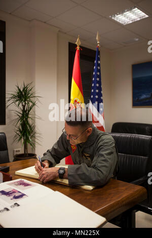 Major Gen. Russell A. Sanborn, the commander of Marine Forces Europe and Africa, signs the Morón Air Base guestbook during a visit to Special Purpose Marine Air-Ground Task Force Crisis Response-Africa at Morón Air Base, Spain, Aug. 9, 2017. SPMAGTF-CR-AF deployed to conduct limited crisis-response and theater-security operations in Europe and North Africa. (U.S. Marine Corps Photo by 1st Lt. Alexandra Bello) - Stock Photo