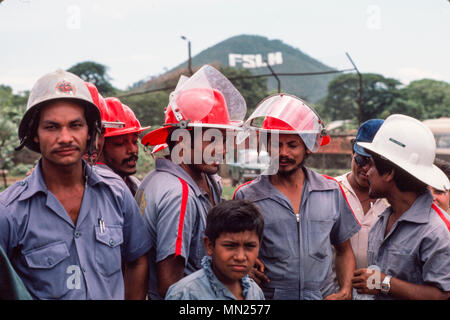 Managua, Nicaragua, June 1986; Factory workers doing fire-fighting training with the city's fire brigade. - Stock Photo