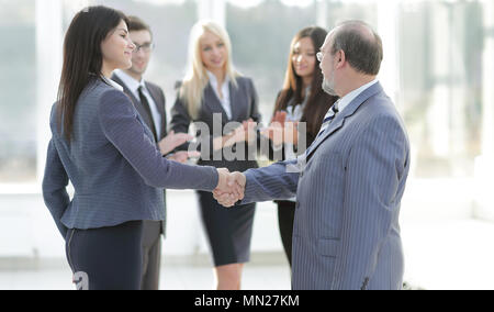 handshake of a businessman and business woman - Stock Photo