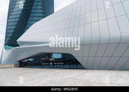 Milan, Italy - May 13, 2018: Citylife Shopping district under the Hadid Tower. It features three shopping areas linked together by a pedestrian pathwa - Stock Photo
