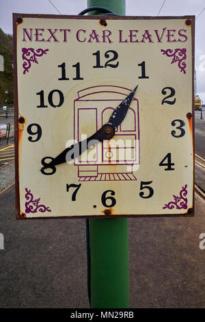 Clockface shows the time of the next electric train to Ramsey from Douglas - Stock Photo