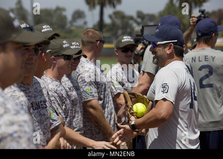 Marines with Marine Corps Air Station Miramar's softball team and San Diego Padres Alumni shake hands prior to playing a softball game on MCAS Miramar, Calif. May 10, May 10, 2018. The Padres Alumni came to demonstrate their support for the military with spirited competition and to thank service members of MCAS Miramar for their service. (U.S. Marine Corps photo by Cpl. Daniel Auvert/Released). ()
