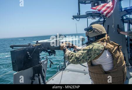 180510-N-NT795-072 SAN DIEGO (May 10, 2018) Quarter Master Seaman Kolton Kelly assigned to Coastal Riverine Squadron (CRS) 3, fires a .50 caliber machine gun aboard MKVI patrol boat during a simulated small boat attack exercise as part of unit level training provided by Coastal Riverine Group (CRG) 1 Training and Evaluation Unit, May 10, 2018. CRG provides a core capability to defend designated high value assets throughout the green and blue-water environment and providing deployable Adaptive Force Packages (AFP) worldwide in an integrated, joint and combined theater of operations. (U.S. Navy  - Stock Photo