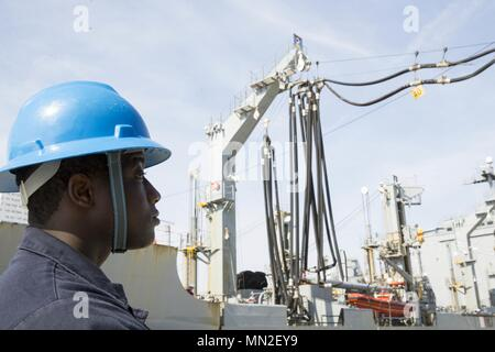 NORFOLK, Va. (May 10, 2018) -- Boatswain's Mate 2nd Class Tyler Wall, from Hardeeville, South Carolina, assigned to USS Gerald R. Ford's (CVN 78) deck department, stands fuel hose watch during a simulated replenishment-at-sea with USNS Leroy Grumman (T-AO 195) at Naval Station Norfolk, May 10, 2018. Ford is conducting test and evaluation operations. (U.S. Navy photo by Mass Communication Specialist 2nd Class Kristopher Ruiz). () - Stock Photo