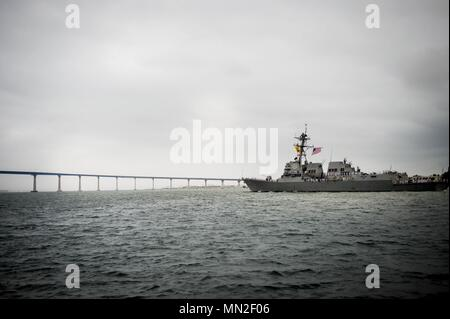The Arleigh Burke-class guided-missile destroyer USS Dewey (DDG 105) arrives in San Diego May 11 following a 90-day deployment, May 11, 2018. Dewey and USS Sterett (DDG 104) conducted operations in the Indo-Pacific Region and supported the Wasp Expeditionary Strike Group (ESG) to advance U.S. Pacific Fleet's 'Up-Gunned' ESG concept. (U.S. Navy photo by Mass Communication Specialist 2nd Class Nancy C. diBenedetto). () - Stock Photo