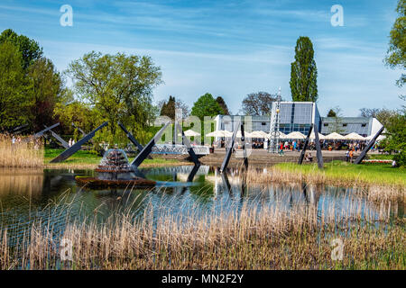 Britzer Garten, Neukölln, Berlin, Germany. 2018. Largest sundial in Europe in front of Orangerie cafe with out door dining area                        - Stock Photo