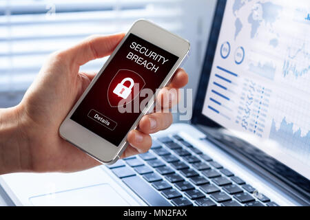 Security breach warning on smartphone screen, device infected by internet virus or malware after cyberattack by hacker, fraud alert with red padlock i - Stock Photo