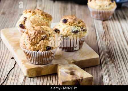 Breakfast cornmeal muffins with raisins, traditional american home baking - Stock Photo