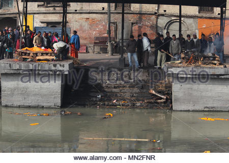 Cremation ghats along the bank of the Bagmati River at Pashupatinath in Nepal. According to Hindu religion and traditions the dead must be cremated. B - Stock Photo