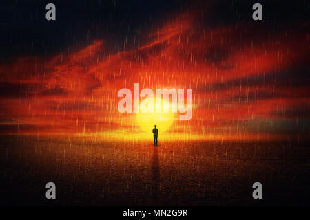 Futuristic scenery view as a man silhouette walking on a dry desert ground over sunset background and the acid rain falling from the sky. Global pollu - Stock Photo