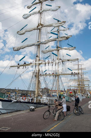 Tall sailing ships Fryderyk Chopin and Sorlandet berthed at Scheveningen harbour, The Hague, Netherlands. - Stock Photo