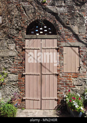 Old Spanish Style Door and Shutter in St. Augustine, Florida, USA, 2018, © Katharine Andriotis - Stock Photo