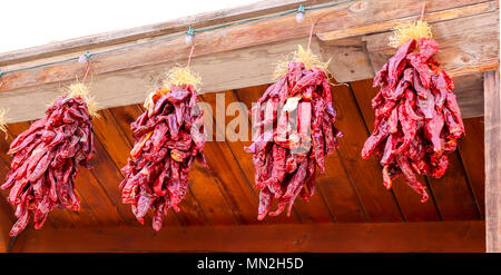 Dried Red Chili Pepper Ristra. Hanging in Old Town Albuquerque, New Mexico, USA. - Stock Photo