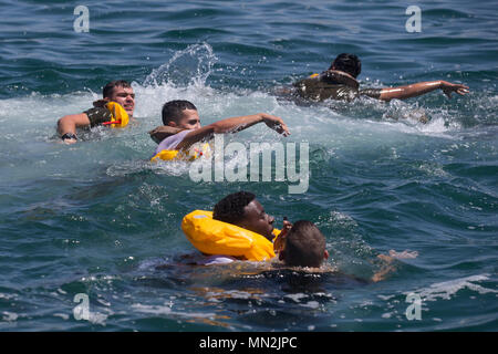 U.S. Marines with 3rd Assault Amphibian Battalion, swim during their annual surf qualification at Camp Pendleton, Calif., Aug. 17, 2017. The annual training included a 500 meter swim from Amphibious Assualt Vehicles (AAV) to shore to simulate an AAV sinking in the ocean. (U.S. Marine Corps photo by Lance Cpl. Roxanna Gonzalez) - Stock Photo
