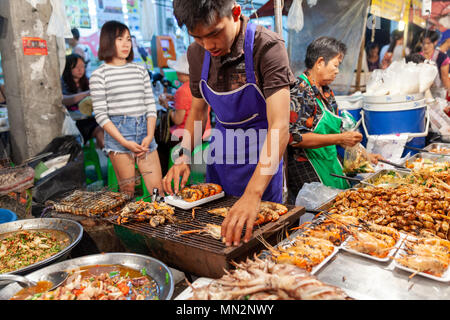 CHIANG MAI, THAILAND - AUGUST 27: Man prepare prawns for sale at the  Saturday night market in Chiang Mai (Walking Street) on August 27, 2016 in Chian - Stock Photo