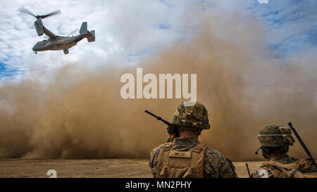 U.S. Marine Corps joint terminal attack controllers communicate with a MV-22 Osprey during takeoff in Hokkaido, Japan, Aug. 18, 2017. This specific Osprey departed from Misawa Air Base, Japan, and landed on Hokkaido for a historical media day event with Japan Ground Self Defense Force Col. Seiichi Iwana, deputy commander of Japan Ground Self-Defense Force 11th Brigade, and Col. James F. Harp, the commanding officer of Marine Aircraft Group 36, 1st Marine Aircraft Wing. Misawa AB has been a hub for U.S. Marine personnel and aircraft, exercising Team Misawa's ability to thrive with an influx of  - Stock Photo