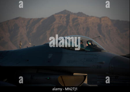 A 555th Expeditionary Fighter Squadron F-16 Fighting Falcon pilot prepares for takeoff at Bagram Airfield, Afghanistan, Aug.22, 2017. The 555th EFS deployed to Bagram Airfield as part of a rotation of fighters, which have had a constant presence in Afghanistan for more than a decade. The F-16s presence here serves the counterterrorism mission and deters actions against coalition forces—day or night. (U.S. Air Force photo by Staff Sgt. Benjamin Gonsier) - Stock Photo