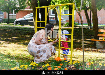 A local national woman plays with her child at a school for handicapped children in Riga, Latvia on Aug. 11, 2017. (U.S. Army photo by Spc. Javon Spence/released) - Stock Photo