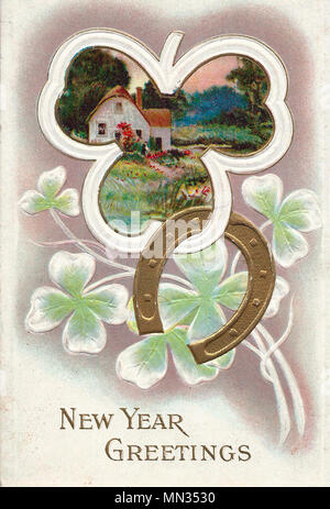 New Years Greetings - A Vintage New Years Post Card - Stock Photo