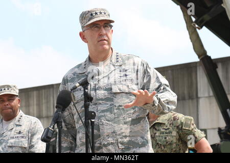 Gen. John E. Hyten, United States Strategic Command commander, spoke at a press conference Aug. 22 held at the Battery D, 6-52 Air Defense Artillery Battalion, tactical site on Osan Air Base, South Korea, in front of two PATRIOT launching stations.    With more than a dozen U.S. and international media outlets on hand, the panel of flag officers took questions from the press about missile defense and rising tensions on the Korean Peninsula. Adm. Harris reiterated to the reporters diplomacy was the most important thing. - Stock Photo
