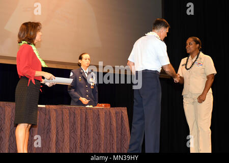 170831-N-ON468-0019 EWA BEACH, HI (August 31, 2017) Brigadier General John Hillyer, Mobilization Assistant to the Director for Operations, Headquarters, U.S. Pacific Command, Camp H.M. Smith, congratulates Chief Information Specialist  Stephanie Wilson for outstanding volunteer service during the 16th annual Joint Venture Education Forum (JVEF) in Ewa Beach, HI. The JVEF is a cooperative partnership between Hawaii's military community, the Hawaii Department of Education, and other community organizations, highlighting the volunteer success stories of Hawaii's military service members, students - Stock Photo