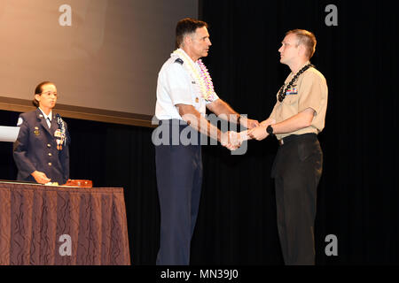 170831-N-ON468-0021 EWA BEACH, HI (August 31, 2017) Brigadier General John Hillyer, Mobilization Assistant to the Director for Operations, Headquarters, U.S. Pacific Command, Camp H.M. Smith, congratulates Aviation Structural Mechanic 1st Class John Newell for outstanding volunteer service during the 16th annual Joint Venture Education Forum (JVEF) in Ewa Beach, HI. The JVEF is a cooperative partnership between Hawaii's military community, the Hawaii Department of Education, and other community organizations, highlighting the volunteer success stories of Hawaii's military service members, stud - Stock Photo