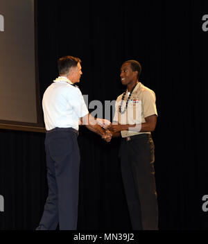 170831-N-ON468-0026 EWA BEACH, HI (August 31, 2017) Brigadier General John Hillyer, Mobilization Assistant to the Director for Operations, Headquarters, U.S. Pacific Command, Camp H.M. Smith, congratulates Aviation Structural Mechanic 1st Class Travis Holloway for outstanding volunteer service during the 16th annual Joint Venture Education Forum (JVEF) in Ewa Beach, HI. The JVEF is a cooperative partnership between Hawaii's military community, the Hawaii Department of Education, and other community organizations, highlighting the volunteer success stories of Hawaii's military service members,  - Stock Photo