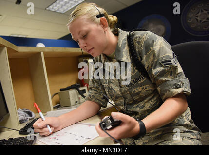 Airman 1st Class Brooke Dobbins, 334th Training Squadron student, reviews study material at Cody Hall Aug. 17, 2017, on Keesler Air Force Base, Miss. Dobbins will graduate with perfect scores throughout the aviation resource management apprentice course Aug. 18. After graduation she will return to the 465th Air Refueling Squadron, Tinker Air Force Base, Okla. (U.S. Air Force photo by Kemberly Groue) - Stock Photo