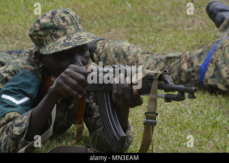 A Uganda People's Defence Force soldier practices the prone firing position in preparation for an upcoming AK-47 rifle range conducted by U.S. Marines with Special Purpose Marine Air-Ground Task Force-Crisis Response-Africa logistics combat element at Camp Singo, Uganda, Aug. 28, 2017. SPMAGTF-CR-AF LCE is deployed to conduct limited crisis-response and theater-security operations in Europe and Africa. (U.S. Marine Corps Photo by Staff Sgt. Rebekka S. Heite/Released) - Stock Photo